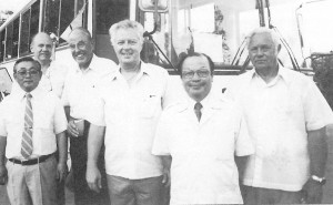 "On April 18, 1984, Commonwealth Motors, a division of Jones & Guerrero Co., was selected by Hino Motors Ltd. of Japan to distribute buses and heavy equipment in Micronesia. At the reception at the Guam Hilton were (from left) ShoichiNagura, managing director, Hino Auto Body Ltd.; Lee Holmes, president of Guam Cable TV; R.T. ""Twick"" Grant, first general manager of Triple J Motors; Robert H. Jones, executive vice president of Jones & Guerrero; Tsunenori Yamauchi, general manager of Hino Motors overseas marketing division; and Kenneth T. Jones Jr., president of Jones & Guerrero."